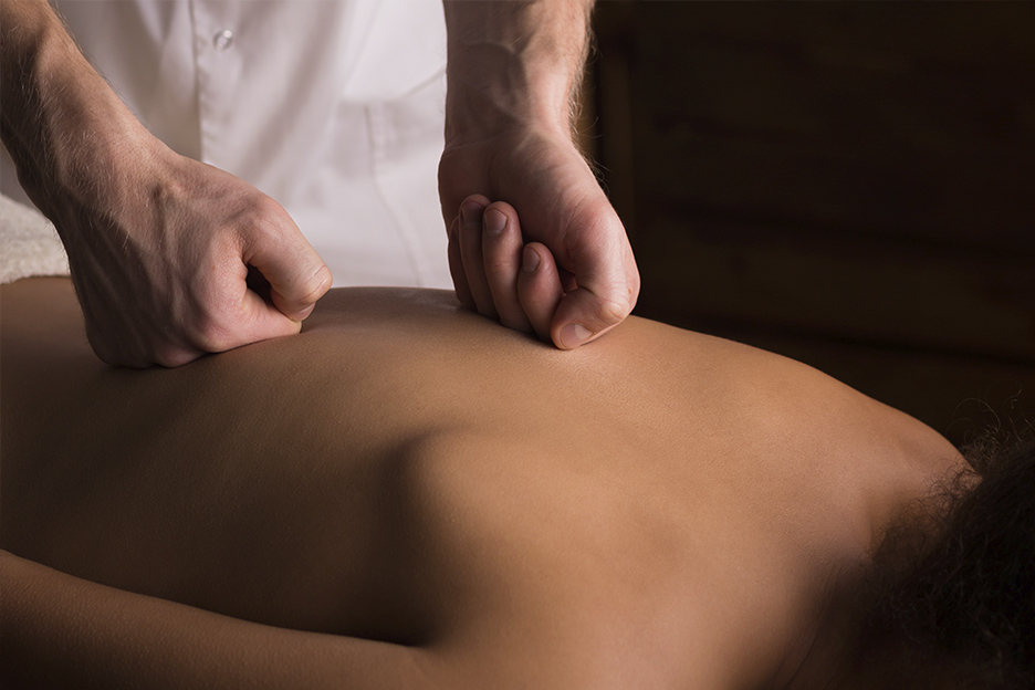 Massage Therapist treating a patient