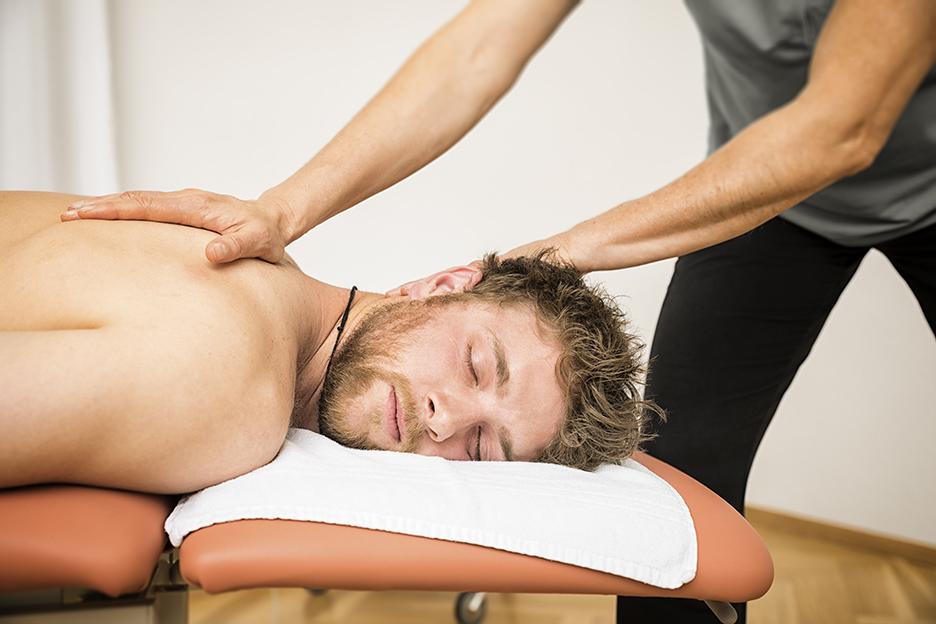 Chiropractor treating man